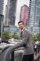 Businessman standing near railing