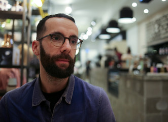 Alan Gertner poses in his new cannabis themed cafe in Toronto