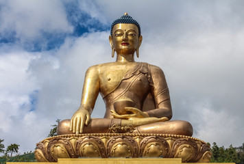 Close up view of giant Buddha Dordenma statue with the blue sky and clouds background, Thimphu, Bhutan