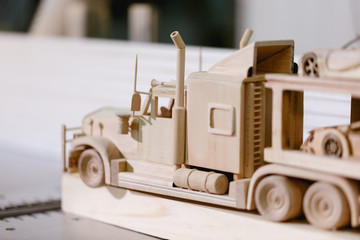 The wooden truck lies on the bars. Side view closeup