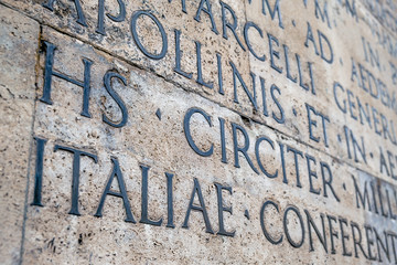 Ancient Latin inscription on the outside wall of Ara Pacis wall in Rome