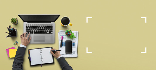 Office workplace with laptop, notebook, hand, office supplies, on khaki background. Solution, business planning, financial analysis, accounting, start up or working flat lay top view concept.