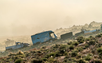 Broken down abandoned rusty cars in the Tunisian countryside. Tataouine, North Africa