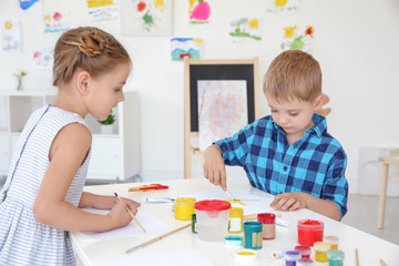 Children at painting lesson in classroom