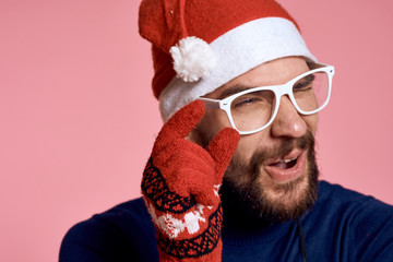portrait of a man in glasses showing the size of his fingers, new year