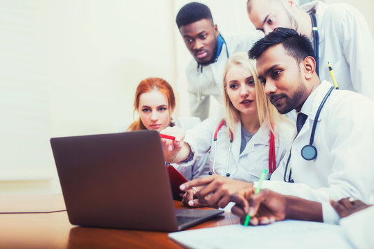 healthcare. A group mixed race of student medical students communicates in front of a laptop. Discussion of the diagnosis