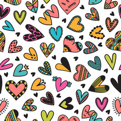 Cute seamless pattern with hand drawn hearts. Cute doodle elements. Background for wedding or Valentine's Day design