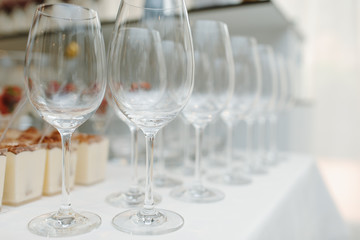 Close up picture of empty glasses on the beige tablecloth  in restaurant