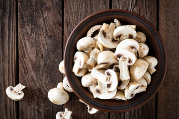 Fresh mushrooms on wooden table, top view