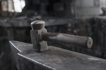 Hammer on anvil at blacksmith shop