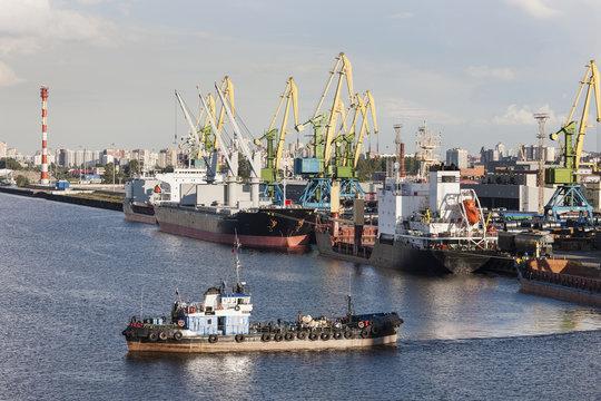 Boat and cranes at Merchant's Harbor, Saint Petersburg, Russia