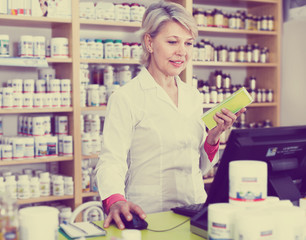 Adult woman writing assortment of care products