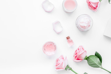 spa set with rose flowers and cosmetic for body on white desk ba