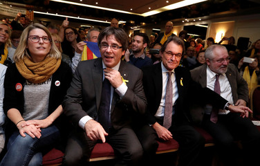 Ousted Catalan leader Carles Puigdemont and former Catalan President Artur Mas attend a aurally with supporters on the eve of a Catalan pro-independence giant protest, in Brussels