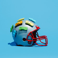 Football helmet with cars isolated on blue background