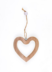 decorative wooden heart on white isolated background