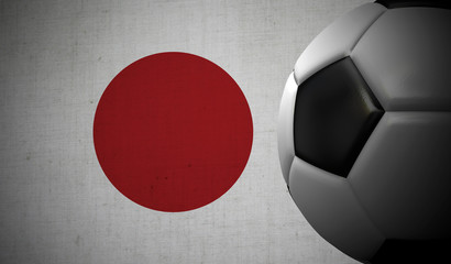 Soccer football against a Japan flag background. 3D Rendering