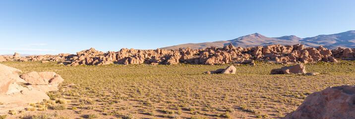 Boulders stone formations landscape Salar De Uyuni, travel Bolivia