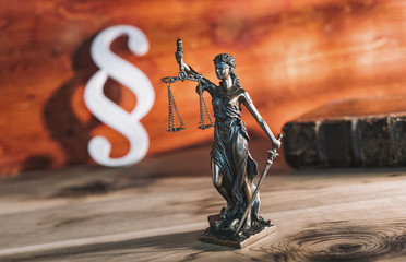 Paragraph icon with Statue of Justice - lady justice or Iustitia / Justitia the Roman goddess of Justice in a lawyer office