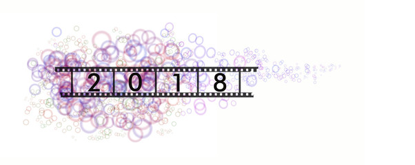 black inscription year 2018 on film tape on a background of colorful, transparent circles and flashes on a white background