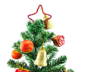 Christmas tree decoration on white background with golden lights glowing.