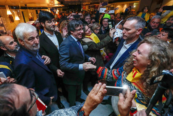 Ousted Catalan leader Carles Puigdemont is surrounded by supporters during a rally in Brussels