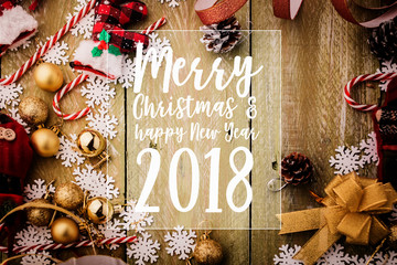 2018 Merry Christmas and happy new year festive background concept with Christmas decorating items on wooden background with light filter