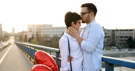 Portrait of loving couple dating at sunset in city