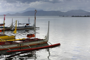 Pump boats in Taal lake under menacing sky. Talisay-Batangas-Luzon-Philippines. 0007