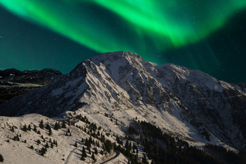 northern lights above the snow-capped mountains