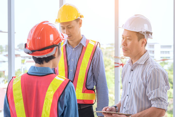 engineering construction teamwork concept : professional engineer work industrial project site