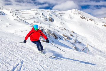 Wall Mural - Man skiing on the prepared slope with fresh new powder snow in Tyrolian Alps, Zillertal, Austria