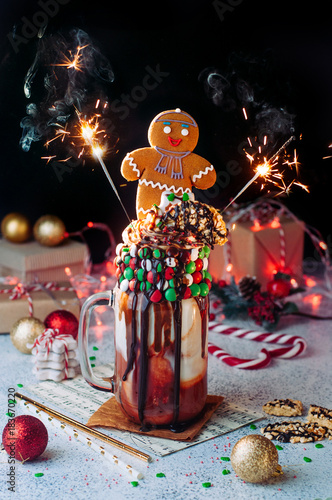 christmas freak shake with sparkler bengal lights topping with gingerbread man on party table