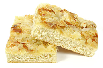 Traditional North German Butterkuchen (butter cake) isolated on white background. Butterkuchen is a favorite element of Westphalian and North German coffee tables.