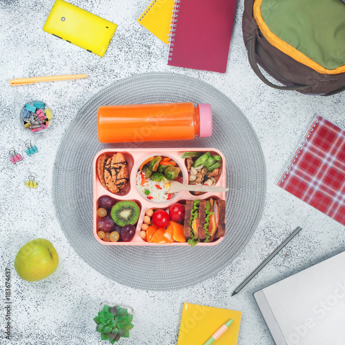 Open Lunch Box With Healthy Food On The Grey Background With
