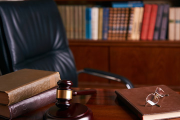 Judge's Gavel or mallet on wooden table
