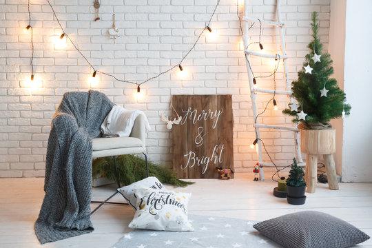 Winter home decor. Christmas tree in loft interior against brick wall. Ol