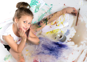 Little girl with a brush in her hand