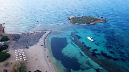 Aerial bird's eye view photo taken by drone of yacht docked and turquoise - sapphire clear waters