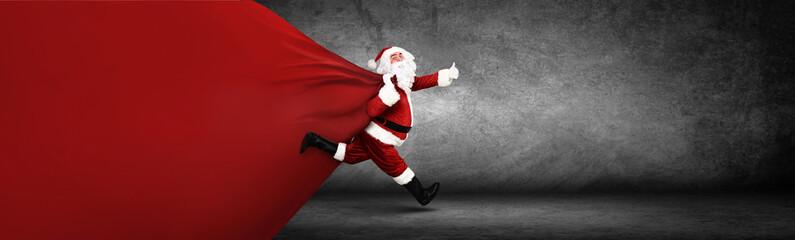 Weihnachtsmann mit einem Sack voller Geschenke!