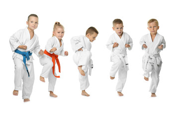 Little children practicing karate on white background