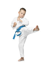 Little boy practicing karate on white background