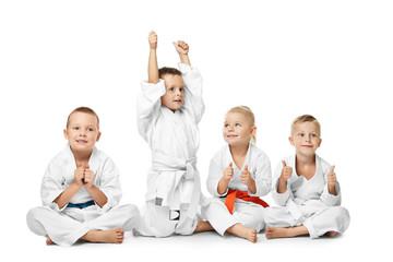 Little children in karategi on white background