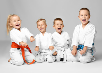 Aluminium Prints Martial arts Little children in karategi on light background