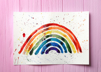Watercolor painting of rainbow on wooden background