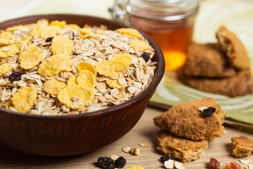 Bowl of Oats and Cereal with Cookies on the Side