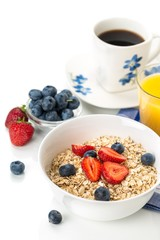 Bowl of Oats with Berry Toppings, Cup of Blueberries, and Cup of