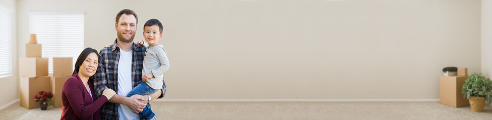 Banner of Mixed Race Chinese and Caucasian Parents and Child Inside Empty Room with Moving Boxes.