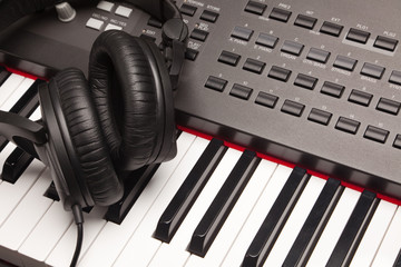 Listening Headphones Laying on Electronic Synthesizer Keyboard