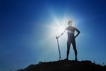 Man Standing Against Sun